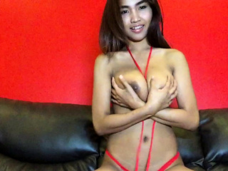Big Tits Thai hottie strips red bikini